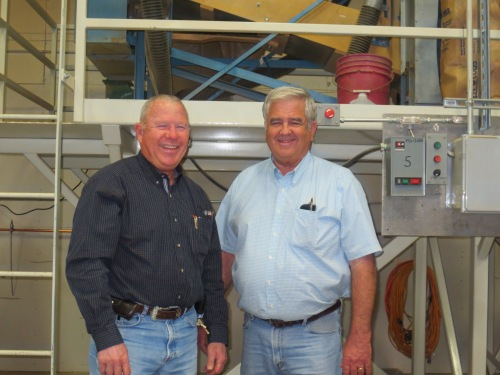 Feft, Jerry Fry and right, Chip Morris in front of their state-of-the-art Visys Python optical sorter that can polish and sort 4,500 lbs. of beans per hour.